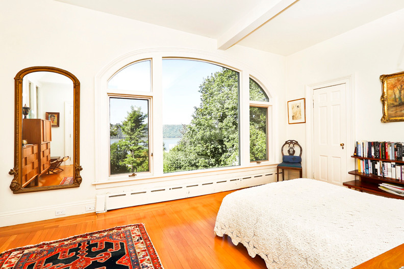 Occupants of the renovated master bedroom can wake up to regal views of the river.