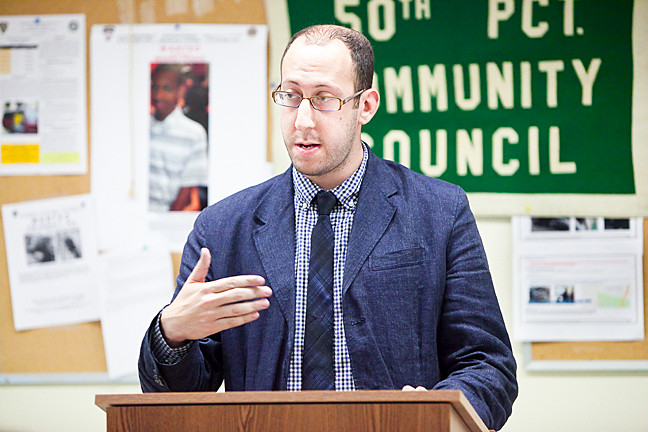 Andrew Sandler, community affairs officer for Councilman G. Oliver Koppell, discusses a range of topics at the 50th Precinct's monthly Community Council meeting.