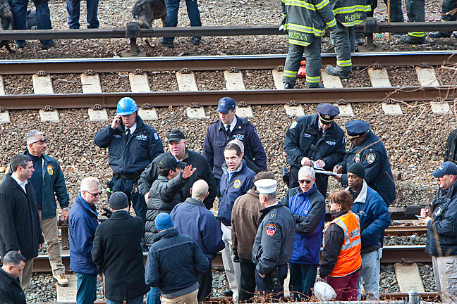 Governor Andrew Cuomo, Chairman and Chief Executive Officer of the MTA Board Thomas F. Prendergast and other officials survey the site of the crash.