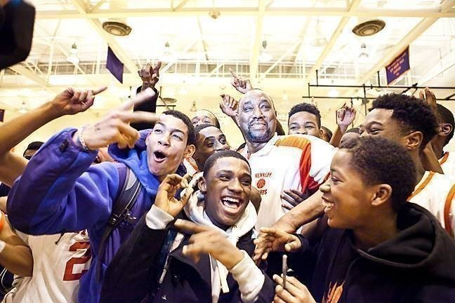 JFK's Johnny Mathis, center, celebrates after winning his 600th basketball game as a coach.