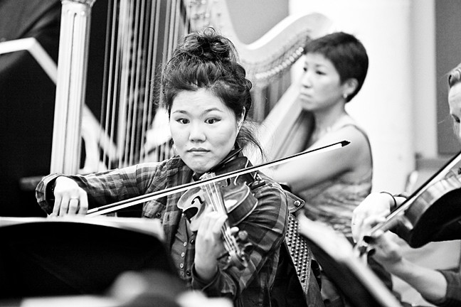 Violinist Susie Park rehearses with the Sinfonietta of Riverdale at Carroll Studios in Manhattan prior to a Riverdale Temple performance on Oct. 27, in which she served as concertmaster.