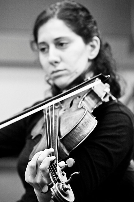 Eva Gerard concentrates on each note as she plays the viola.