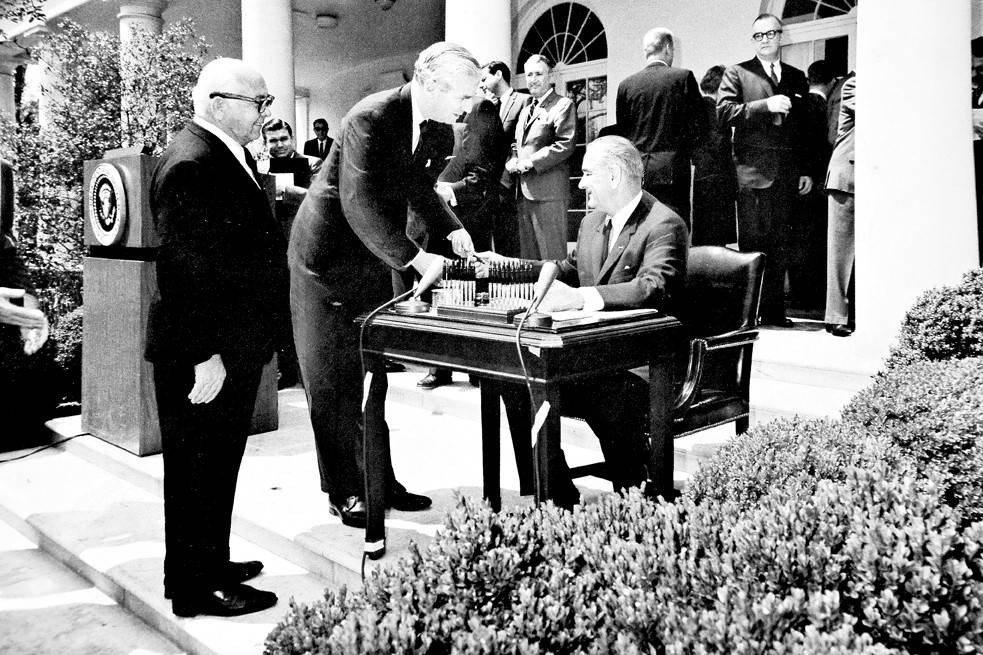 Jonathan Bingham President Lyndon B. Johnson hands a commemorative pen to Congressman Jonathan Bingham at a White House bill signing in May 1965.