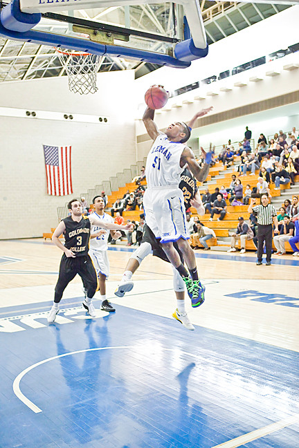 Stanley Stephens, No. 51, for the Lehman College Lightning attempts to score against the Colorado College Tigers at the APEX Arena during Saturday's seventh annual Coaches vs. Cancer Basketball Classic.