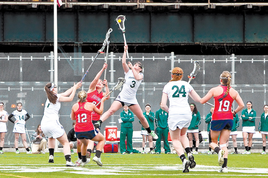 Clare Kerrisk No. 3, of the Manhattan College Jaspers Woman's Lacrosse, leaps in the air to gain control over the ball over the Fresno State Bulldogs in a March 29 game at Gaelic Park.