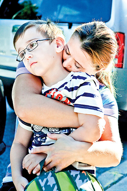 September 9 - Lisa Hoti, comforts her son Elton, 5, as she sends him off to kindergarden at PS 24.