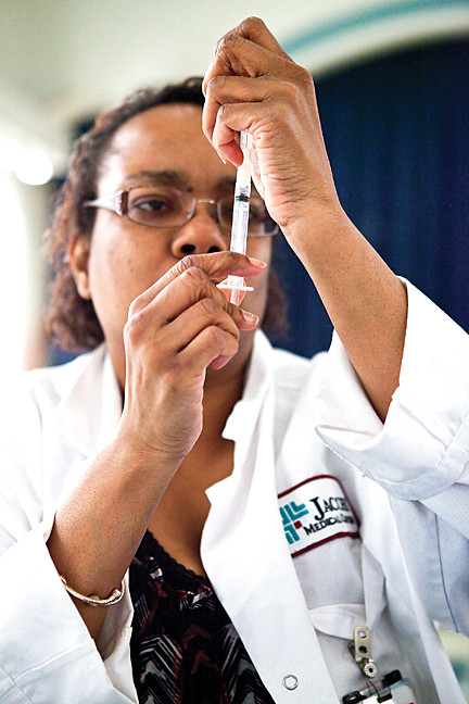 February 7 - Kylia Easter, a nurse with Jacobi Medical Center, prepares a flu shot at the Amalgamated Housing Cooperative.