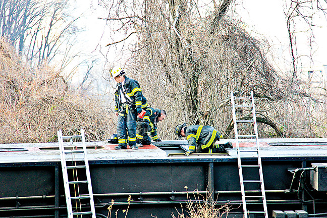 December 1 - Rescue workers, rush to free passengers from the wreckage of a derailed Metro-North train.