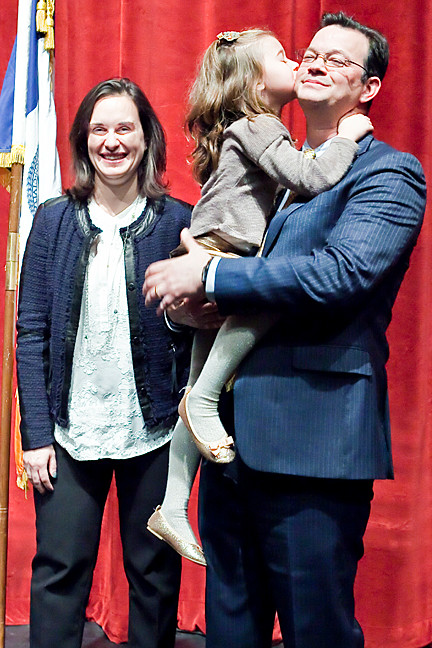 Newly elected Councilman Andrew Cohen gets a kiss from his 5-year-old daughter Sarah after taking the oath of office at Lehman College's Lovinger Theatre on Sunday.