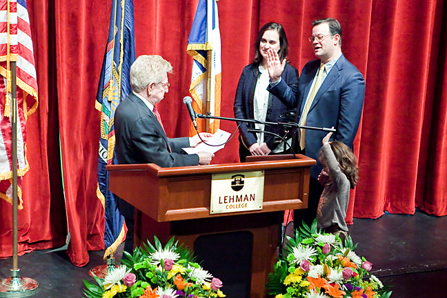 State Supreme Court Justice Edgar Walker administers the oath of office to Councilman Andrew Cohen as his wife Heather Erhard and their daughter Sarah stand by his side.
