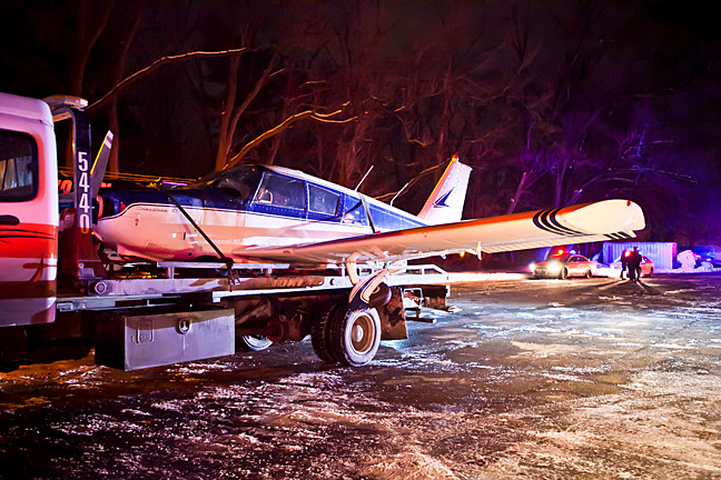 The small airplane that made an emergency landing on the Major Deegan Expressway Saturday afternoon reaches a parking lot south of Van Cortlandt Park Golf Course later that evening. A preliminary report on the incident is expected next week.