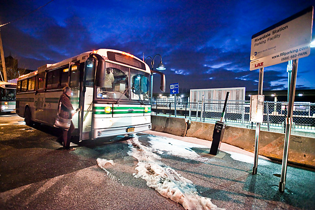 Hudson Rail Link buses — operated by Logan Bus Company since Jan. 2 — wait for commuters at the Riverdale train station on Monday.