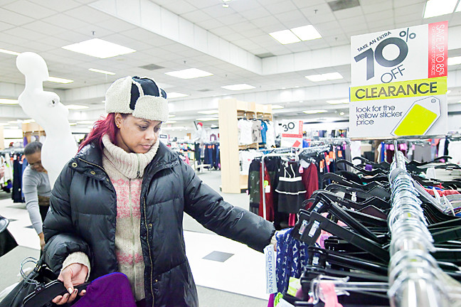 Tanique Barksdale, 35, takes advantage of the steep sale at Loehmann�s as she shops for clothing on Jan. 9.
