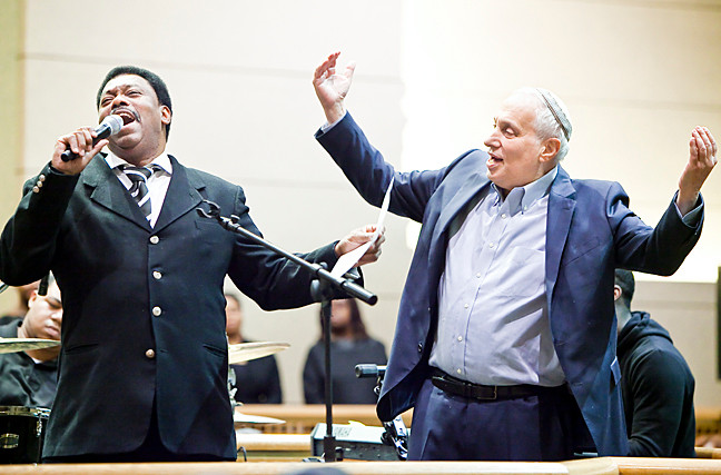 Rev. Roger Hambrick of the Green Pastures Baptist Church and Rabbi Avi Weiss of the Hebrew Institute of Riverdale (HIR) celebrate Martin Luther King, Jr. Day in song on Monday at HIR.