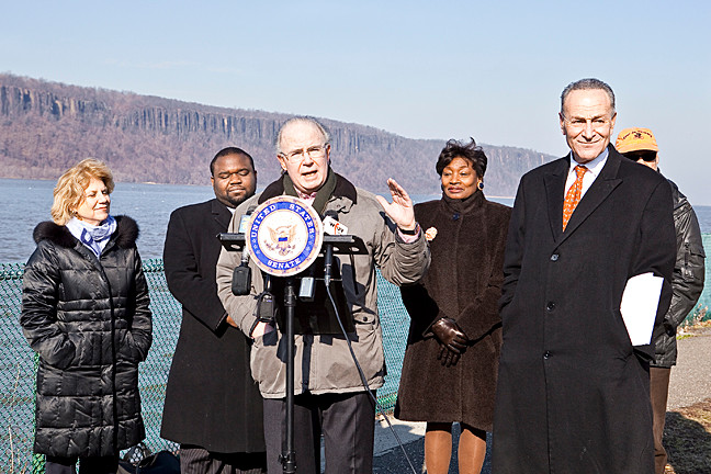Paul Elston, center, representing Friends of the Hudson River Greenway, and U.S. Senator Charles Schumer, right foreground, and other government officials at the JFK Marina and Park in Yonkers announced a push for funding to build the leg of the trail that runs through Riverdale on Jan. 17.