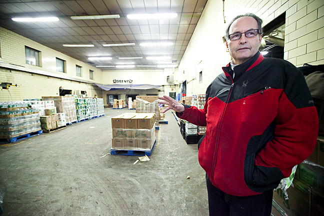 Co-Owner Steve Kleinman stands in what was once the milk processing room at Country Delite on Jan. 17, the day his store closed.