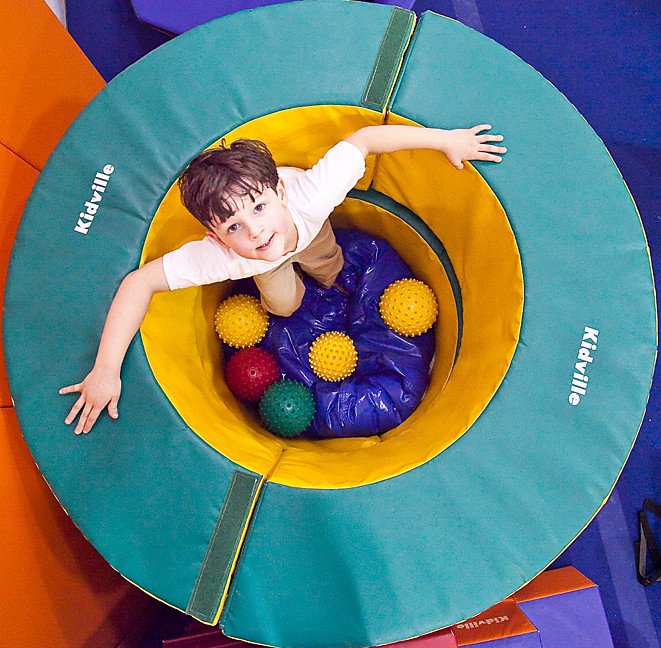 Noah Bellin, 4, plays in a soft wheel at Kidville on Monday. The children's play and party space has been on West 235th Street for about half a year, but invited the community to a 10th birthday bash for its national parent company.