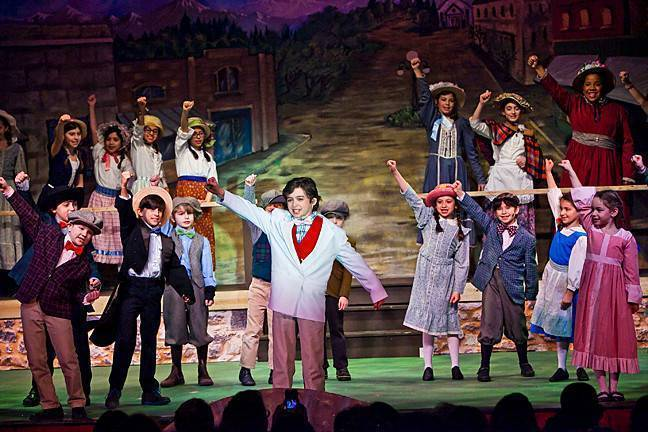 Thomas Grant, 11, as Professor Hill, takes center stage at the Riverdale Junior Rising Stars' Jan. 12 production of 'The Music Man Jr.' at the Riverdale YM-YWHA.