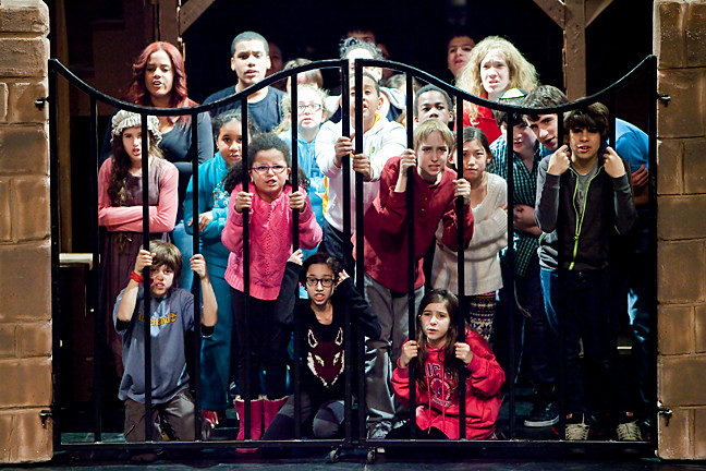 Young French revolutionaries gather at the gate during a Jan. 30 rehearsal of the Riverdale Children's Theatre production of 'Les Misérables School Edition.'