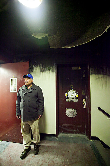 Pedro Cedeño, 74, holds the elevator door as he stands next to the 7th floor apartment where the fire began at 445 West 240th Street on Jan. 30. Mr. Cedeño lives next door with his wife and daughter, who went door-to-door alerting neighbors about the blaze.