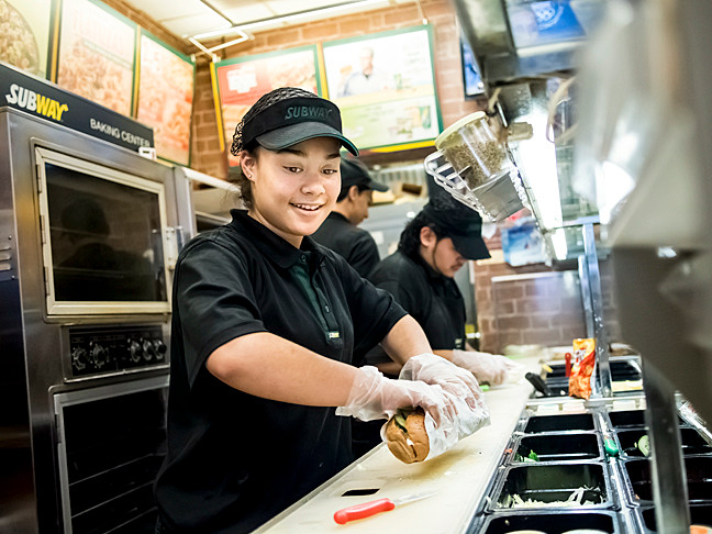 Michelle Gutierrez, 18, wraps a sandwich at her job at Subway on Feb. 6. She graduated from John F. Kennedy High School earlier this year.