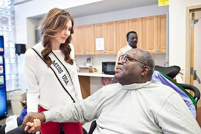 Army veteran Richard Robinson meets Miss USA, Erin Brady, at the annual Valentines for Veterans Celebration on Feb. 14 at the James J. Peters VA Medical Center.