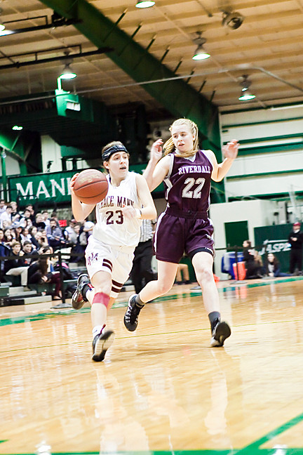 Jen Reiss, an 11th grader for Horace Mann dribbles for the basket as 9th grader Catherine Goodell tries to defend for Riverdale.