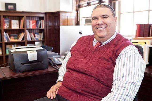 Santiago Taveras in his office at DeWitt Clinton High School. After taking over as principal in August 2013, he has worked to turn around the failing school.