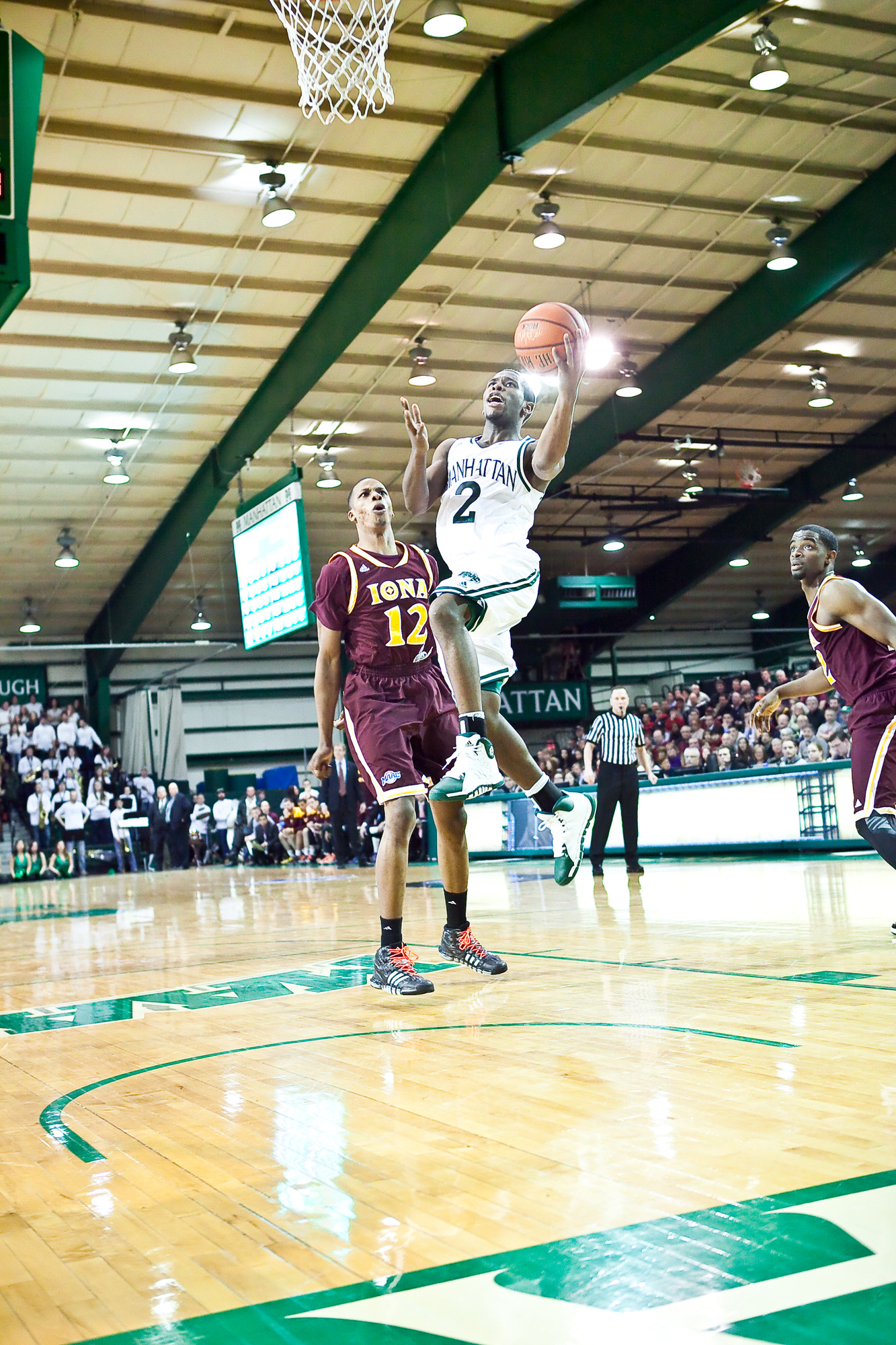 RaShaw Stores scores two of his 15 points for Manhattan College on Saturday. The Jaspers' overtime defeat of Iona at Draddy Gymnasium took them one step closer to the NCAA tournament.