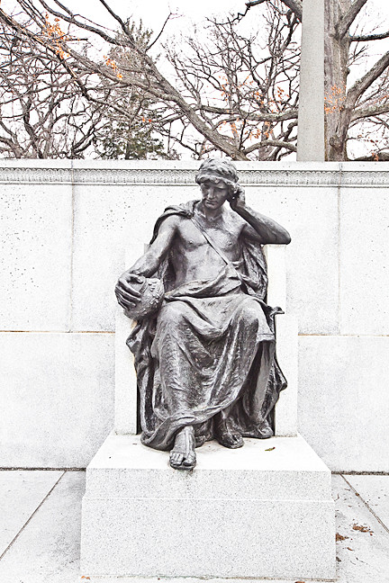 A contemplative figure in bronze adorns the grave of Joseph Pulitzer, namesake of the most prestigious prize in journalism.
