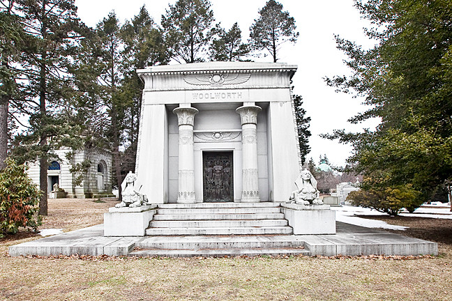 Frank Winfield Woolworth, owner of the five-and-dime stores, rests at Woodlawn Cemetery with female sphinxes at the entrance of the tomb at each side.