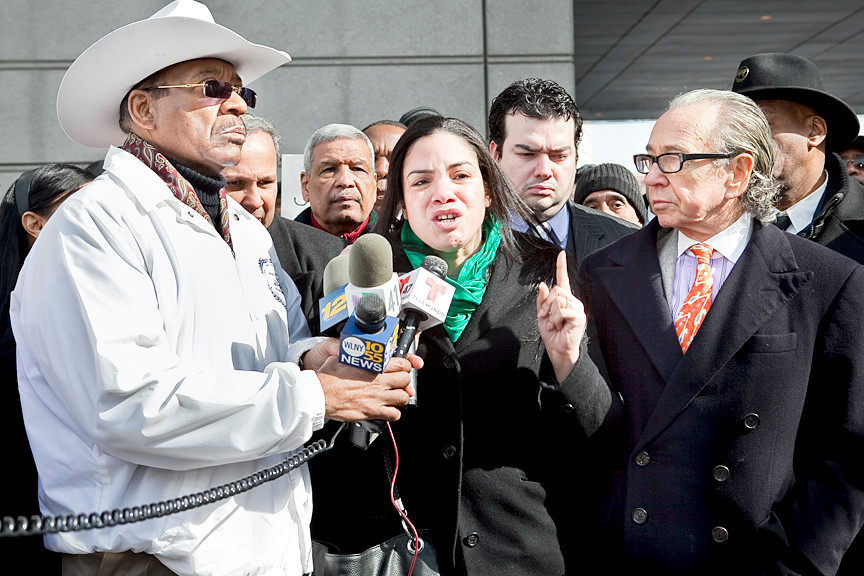 Loida Rivera calls for justice for her mother and other people who cannot speak for themselves beside state Sen. Ruben Diaz Sr. and attorney Sanford Rubenstein outside the Criminal Division of the Bronx Supreme Court on Thursday.