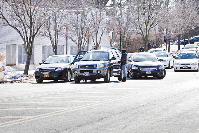 Double parked cars are visible in front of the P.S. 24 annex on the afternoon of March 6.