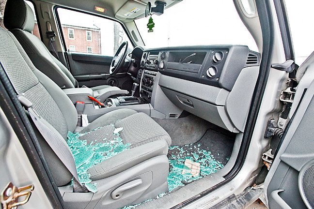 A silver Jeep 4x4 was one of three cars broken into while parked on Riverdale Avenue between West 261st and West 263rd streets on Monday morning next to the College of Mount Saint Vincent.