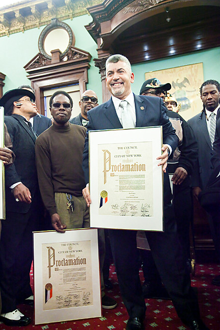 Joe Conzo, right, who photographed the birth of hip hop, stands next to Jazzy J, part of the Zulu Nation and the rest of the hip hop founders as they receive the city Proclamation.