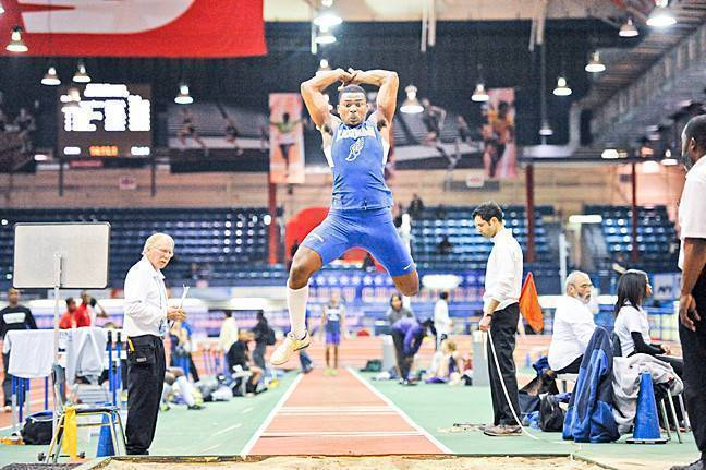 Pierre Francois executing the triple jump at the New Balance Track and Field Center at the Armory for the CUNY Athletic Conference Indoor track and field Championships on March 2.