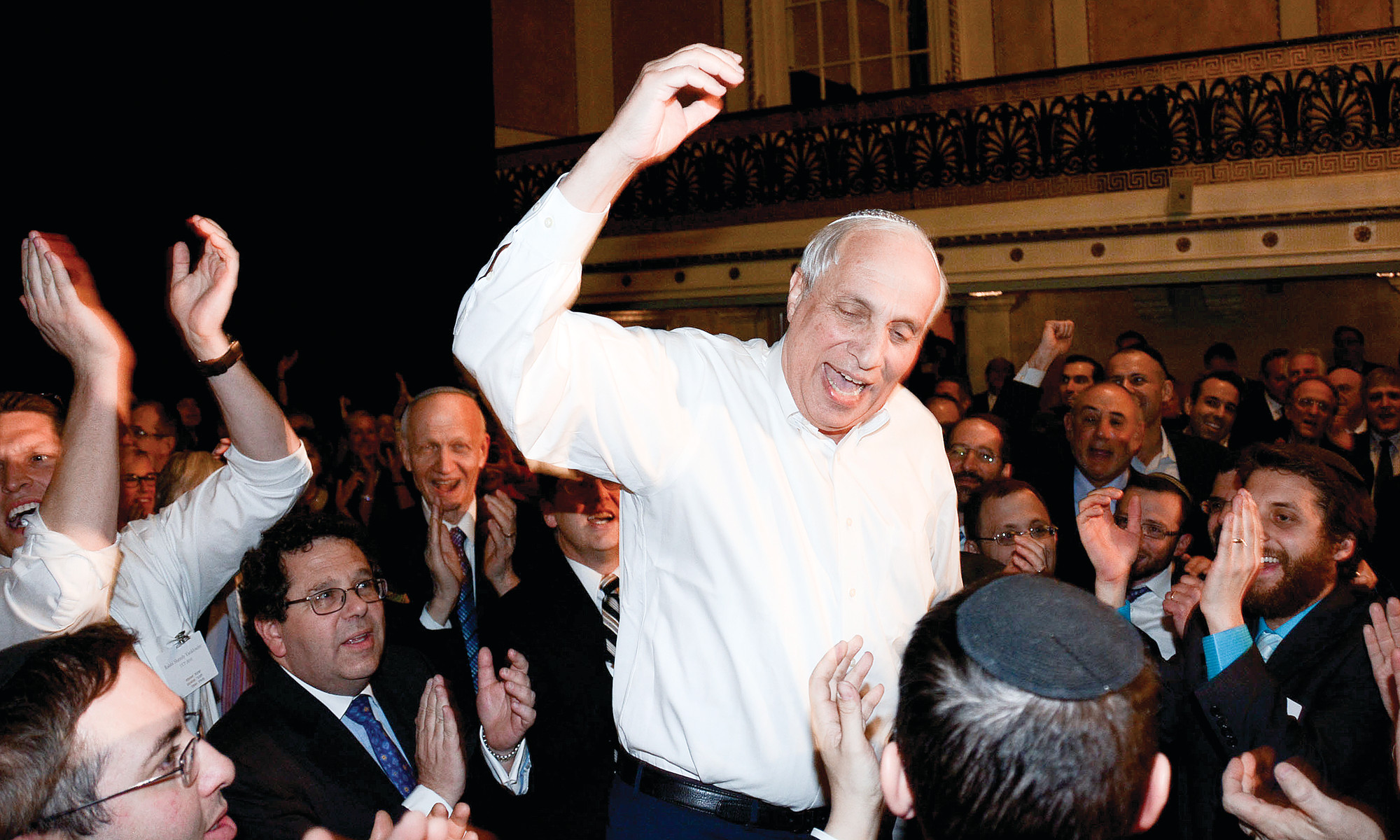 RABBI AVI WEISS dances before guests hoist him on a chair at a gala in his honor at the Roosevelt Hotel on Sunday night.
