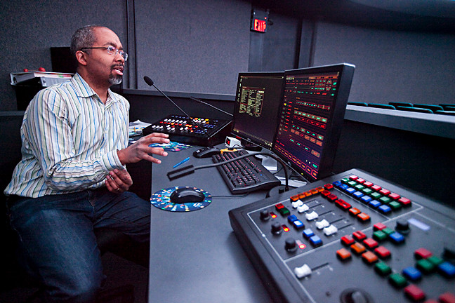 Marc Taylor, manager of the Andrus Planetarium at the console of the renovated planetarium computer