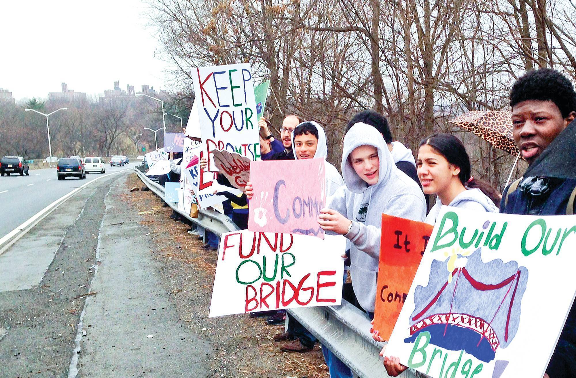 Protesters gather along the Major Deegan Expressway on Saturday to demand a pedestrian footbridge that they say is long overdue even though a city agency calls the issue a non-starter.