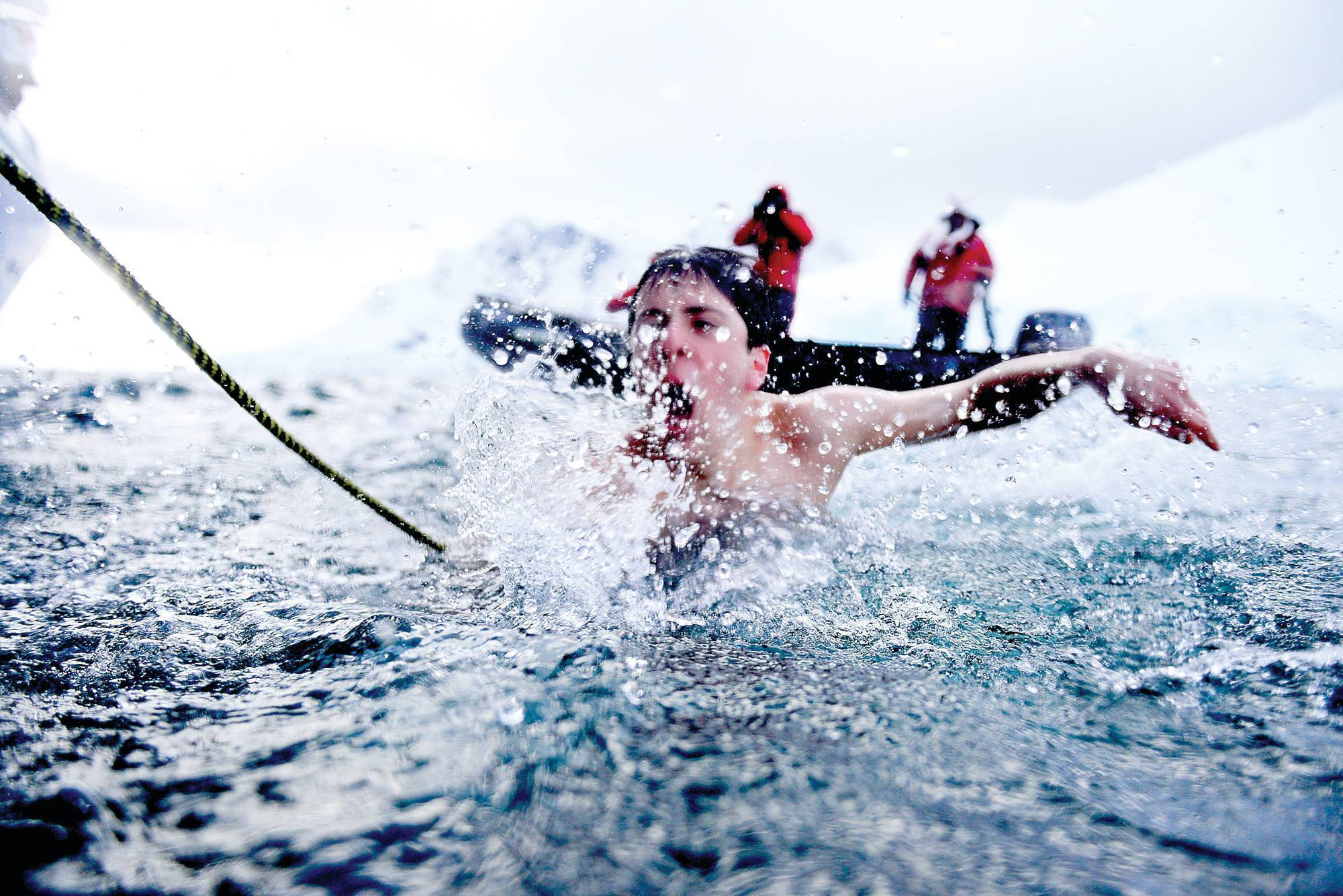 DAVID FISHMAN goes for a swim in the 28-degree waters of Antarctica's Orne Harbor on March 16 as part of the 2041 Antarctic Youth Ambassador Program.