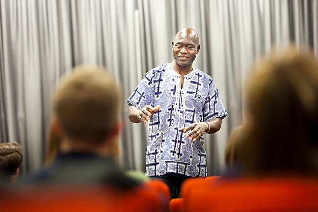 Catholic Relief Services worker Thomas Awiapo speaks to students at Manhattan College's Hayden Auditorium on Monday.