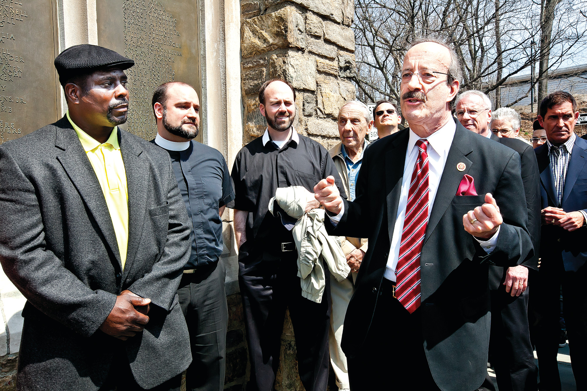 CONGRESSMAN Eliot Engel, at right in foreground, spoke before a gathering of residents, religious leaders and elected officials at a Sunday vigil in support of Menuhin Hart, left. Unknown vandals have besmirched Mr. Hart's truck with racist graffiti. Behind Mr. Engel are state Sen. Jeff Klein, Assemblyman Jeffrey Dinowitz and Councilman Andrew Cohen.
