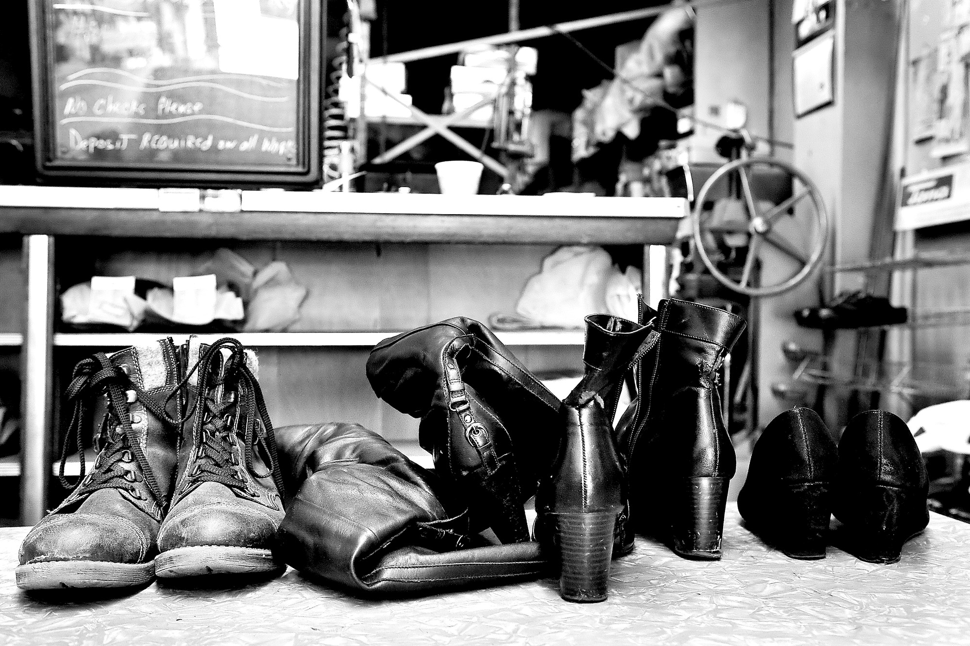 Boots and shoes waiting to be fixed.