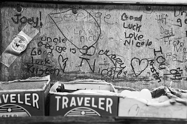 The side of the counter at Chris Shoe Repair on 507 West 236th St. bears well wishes from the owner's son Joey, his daughter Nicole and his niece Kristen.