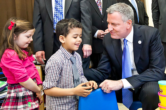 Emma and Lugas, both 4, speak with Mayor Bill de Blasio during his visit to their pre-kindergarten class at Riverdale Neighborhood House on Monday.