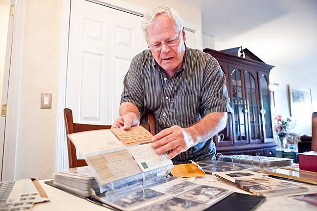 Thomas Casey of the Kingsbridge Historical Society shows his postcard collection. Each post card depicts a time or place with historical or personal significance.