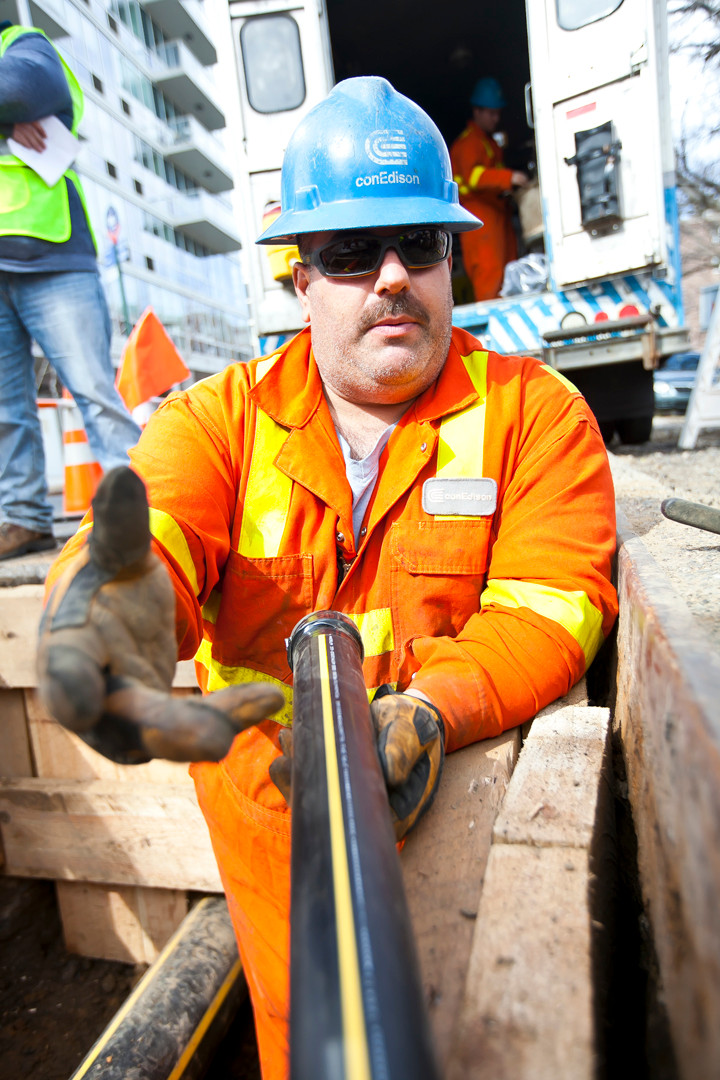 Mike Macario, an operation mechanic for Con Ed, holds a two-inch pipe that bring gas to 3611 Henry Hudson Parkway.