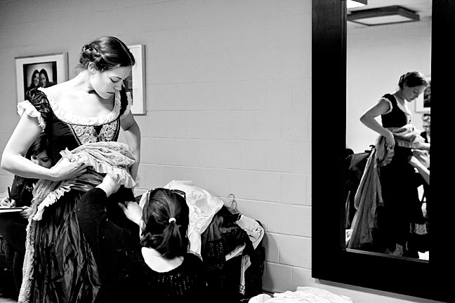 Costume designer Victoria Depew fits a dress for Laura Flaxman, who plays Flora in the show.