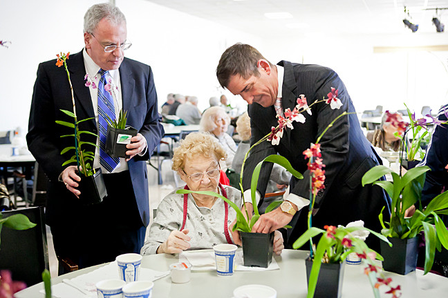 Margaret O'Donohue, 90, receives an orchid at the Riverdale YM-YWHA from state Sen. Jeff Klein, who delivers the exotic flowers from the New York Botanical Garden in an annual tradition. Assemblyman Jeffrey Dinowitz looks on while readying to spread more flora.
