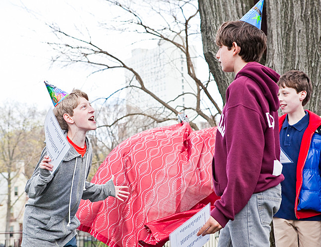 Benjamin Kaufman, 13, playfully hurls insults at Justin Kretschman, also 13, at Riverdale Country School's celebration of Shakespeare's 450th birthday.